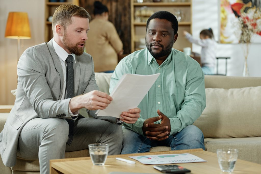 Black man with consultant on mortgage
